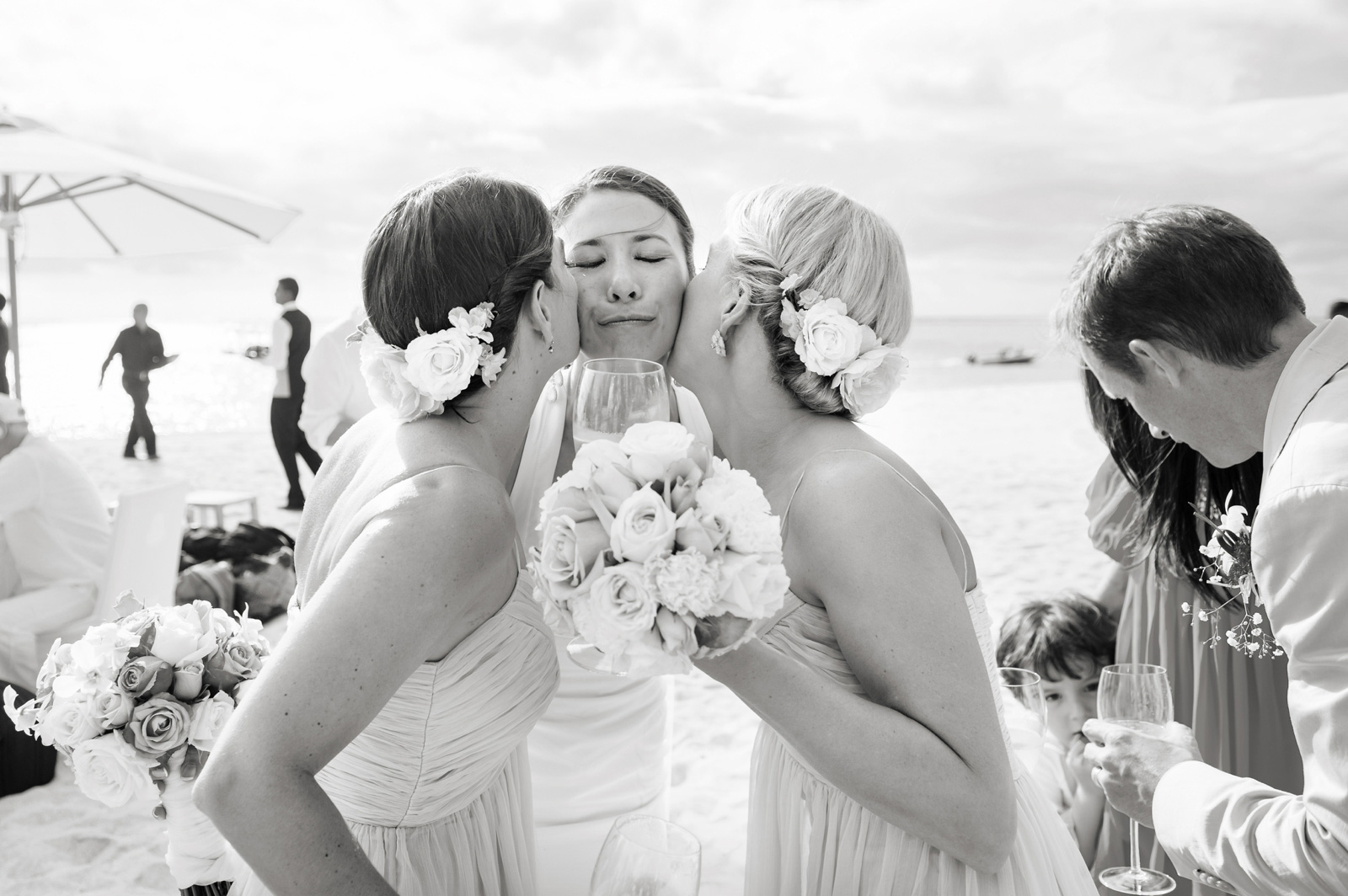bridesmaids kissing bride