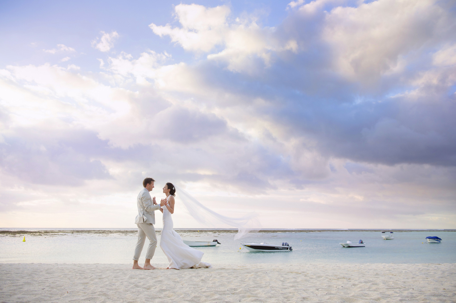 Bride and groom on La Morne beach St Regis