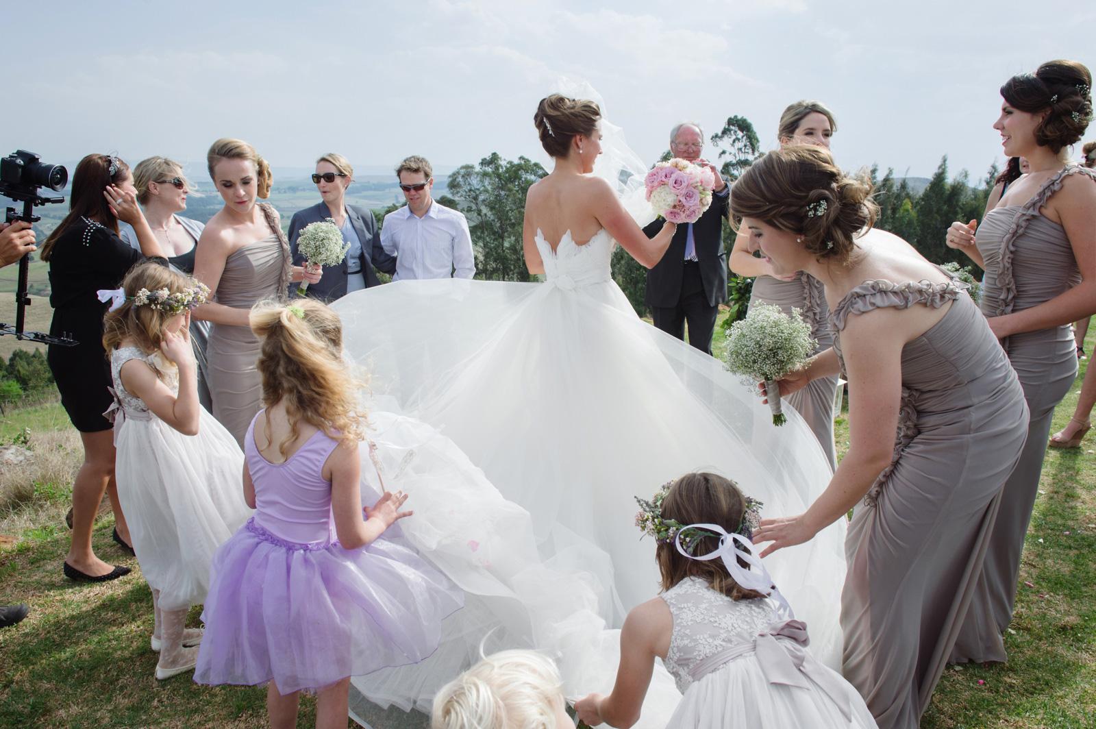 girls fixing wedding dress