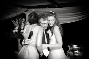 mom and daughter hug father