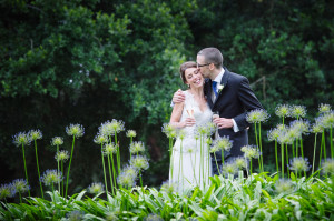 bride and grrom in grass
