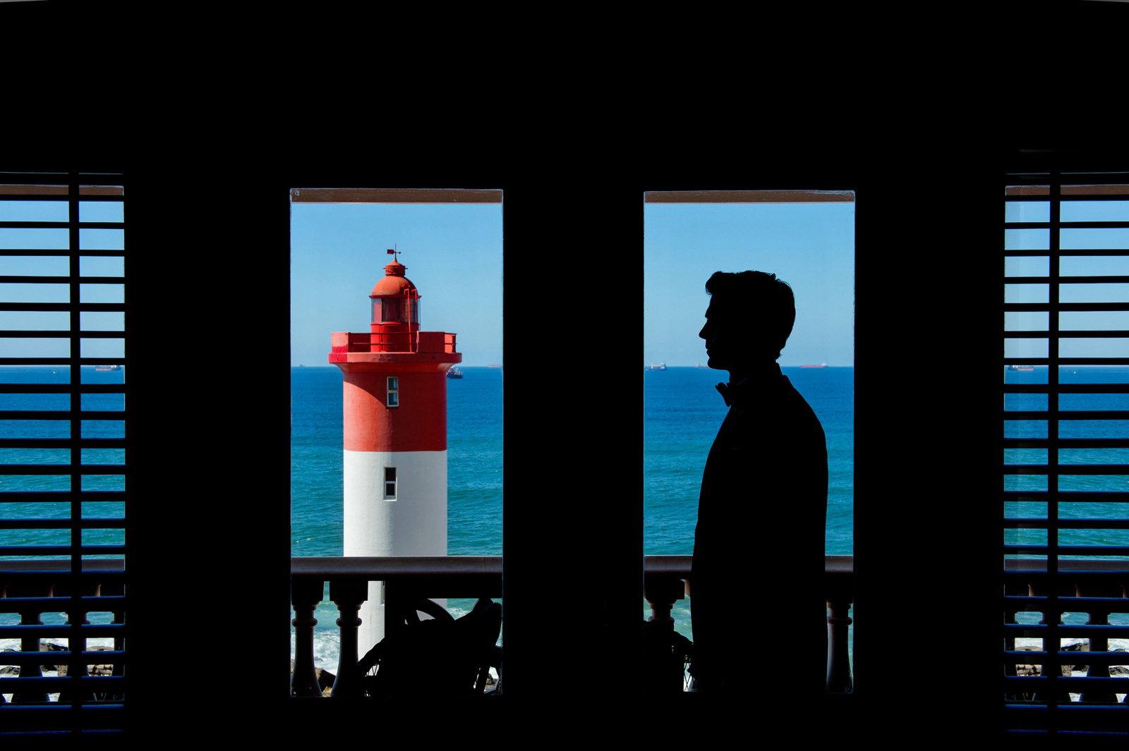 man and lighthouse