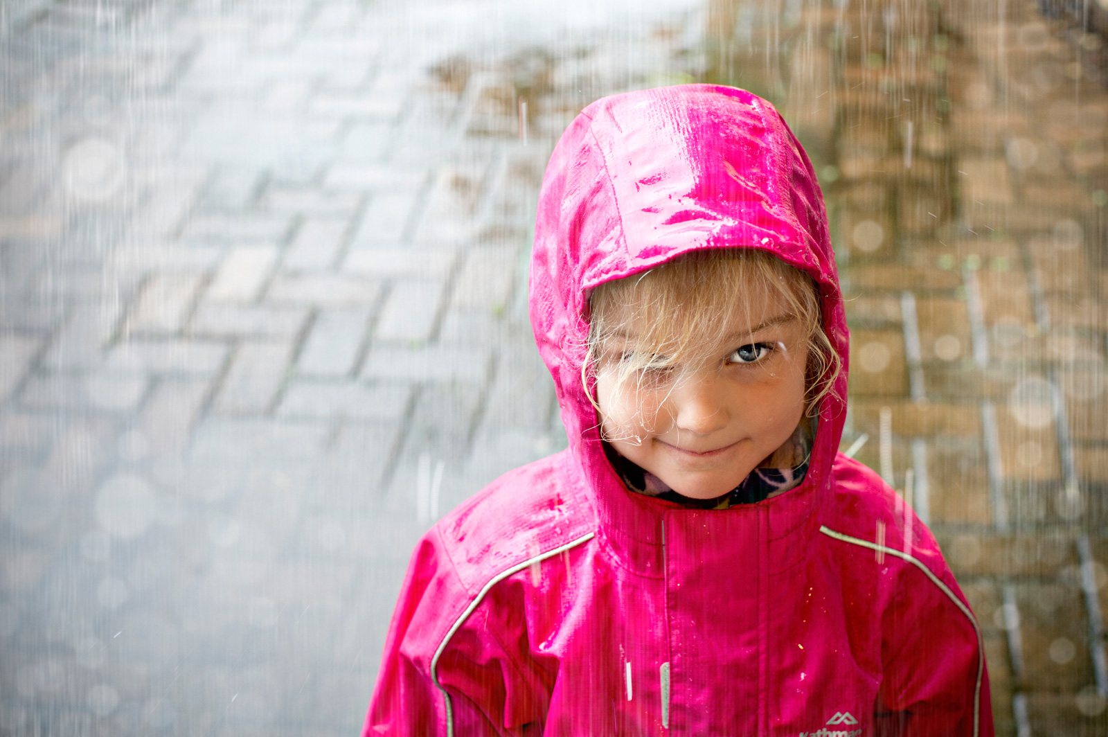 girl in pink rain coat