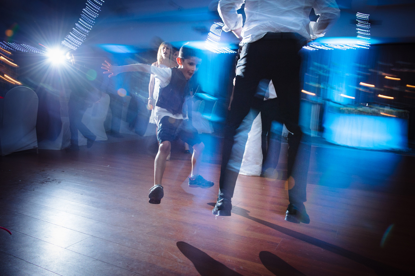 child dancing at wedding