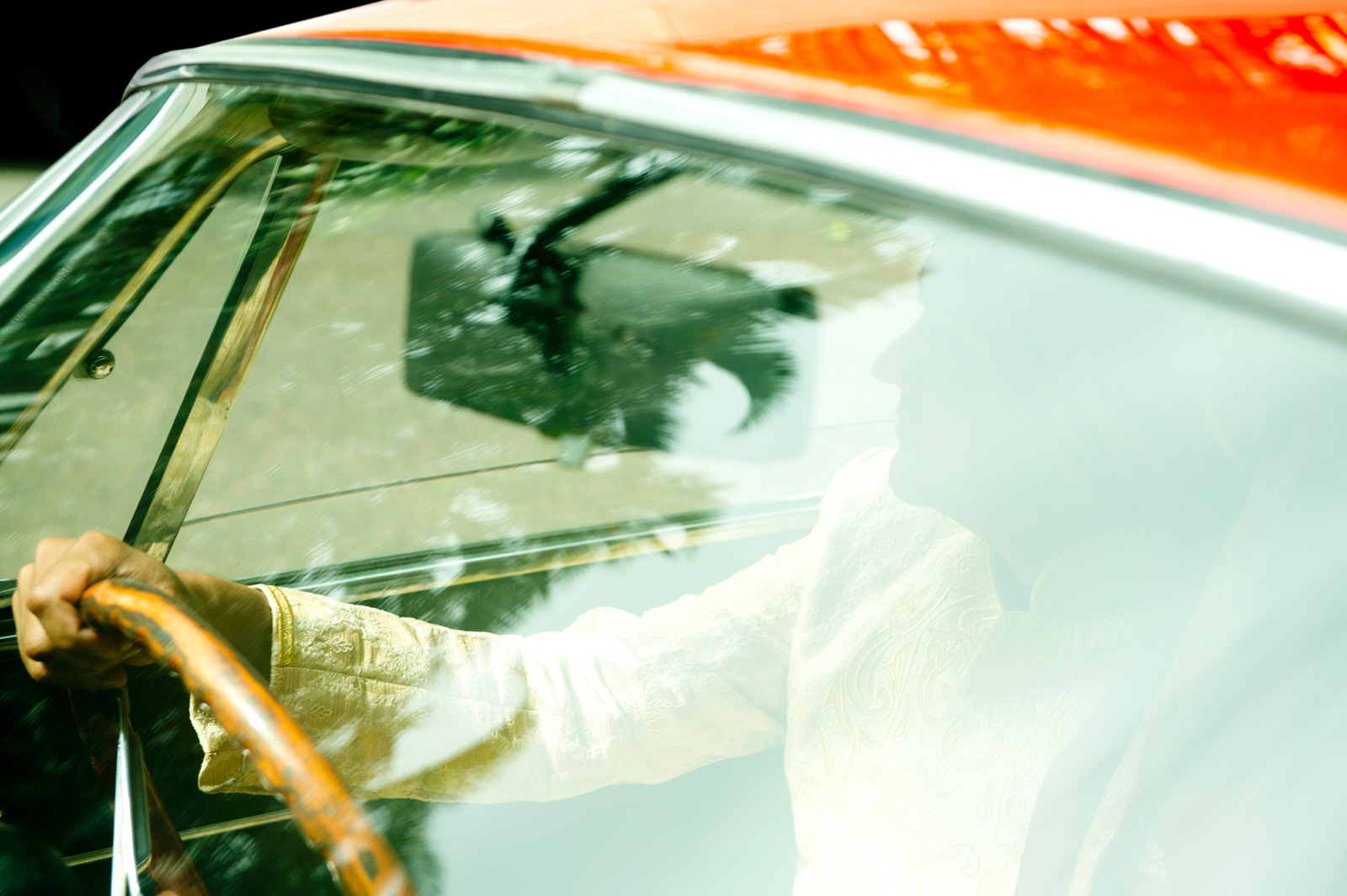Hindu Christian Wedding Documentary Wedding Photographer Groom in car