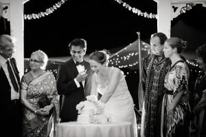 Hindu Christian Wedding Documentary Wedding Photographer Reception Cake cutting