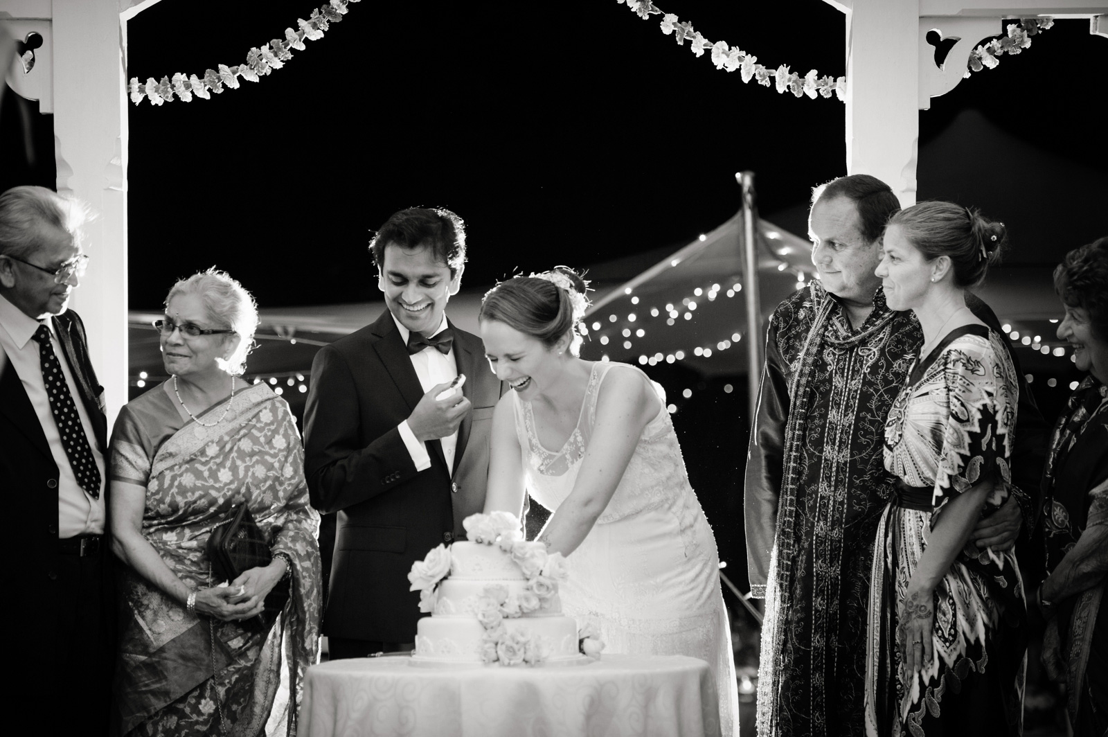 Hindu Christian Wedding Documentary Wedding Photographer Reception Cake cutting