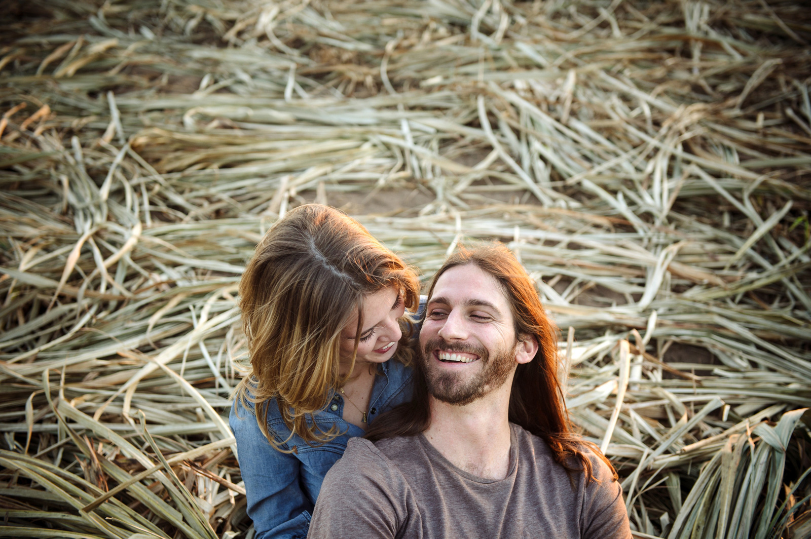 Couple in sugar cane field