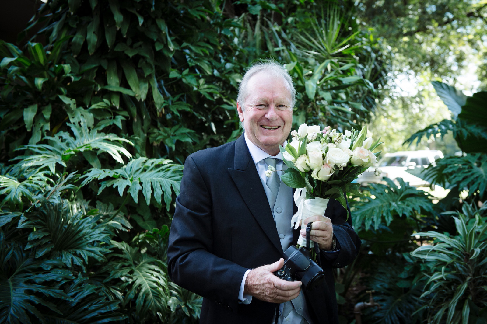 Father of the bride with bouquet