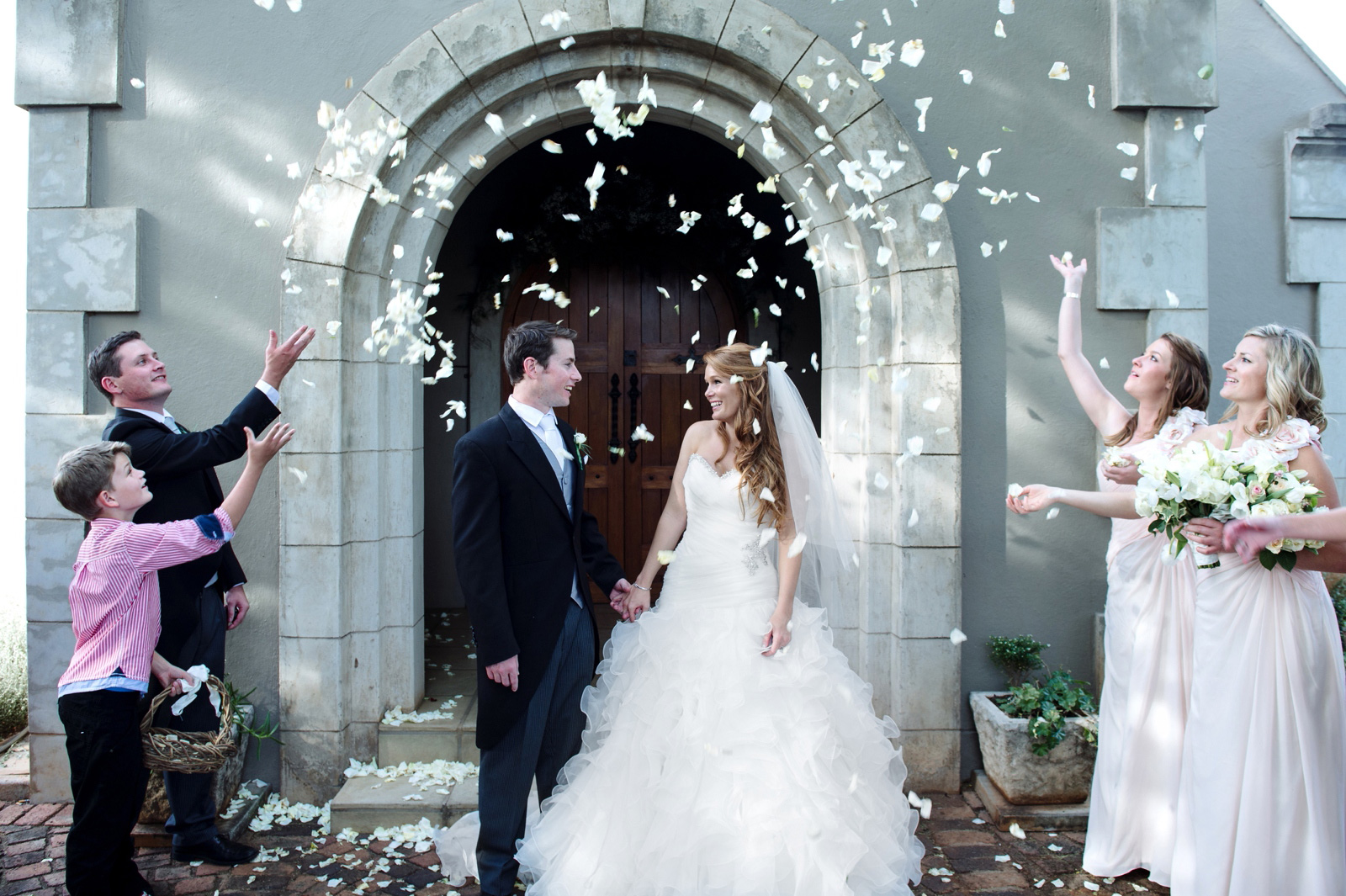 Bride and Groom congratulations with rose petal confetti