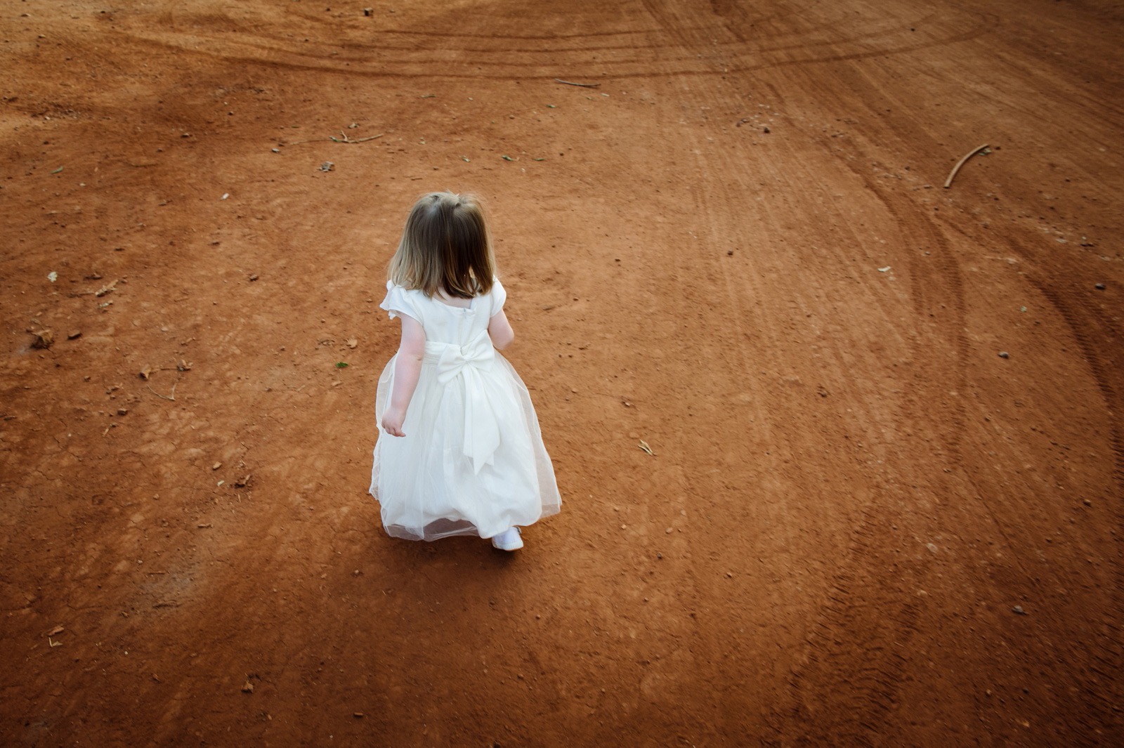 Cute girl on dirt road