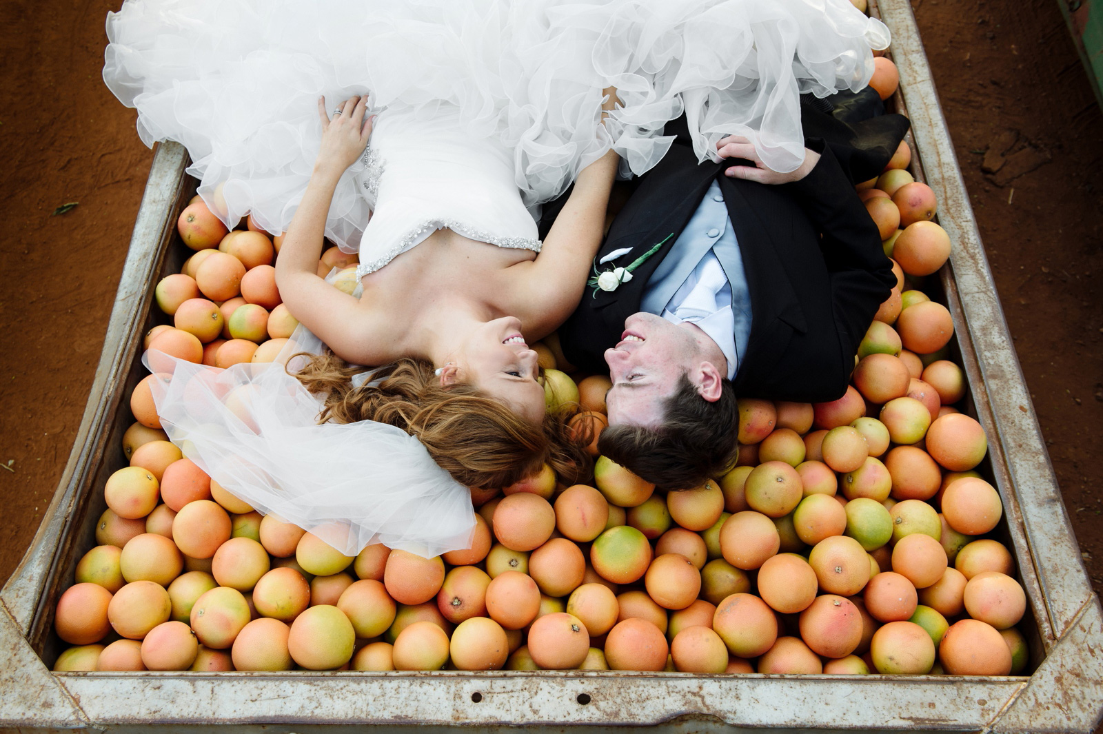 Bride and Groom on a pile of fruit