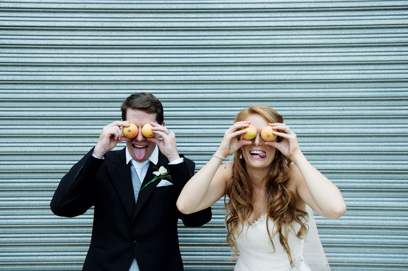 Quirky wedding pic with grapefruit