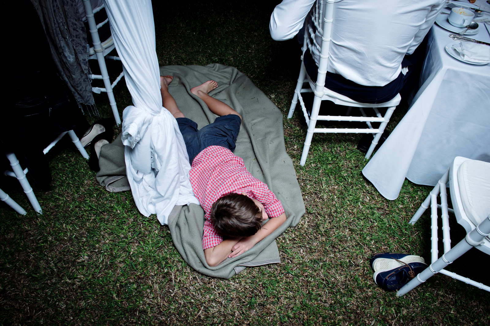child sleeping at wedding