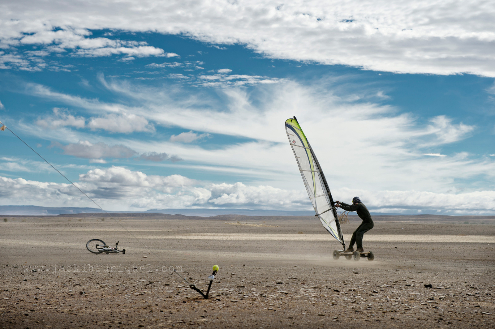 Man wind surfing during dust storm