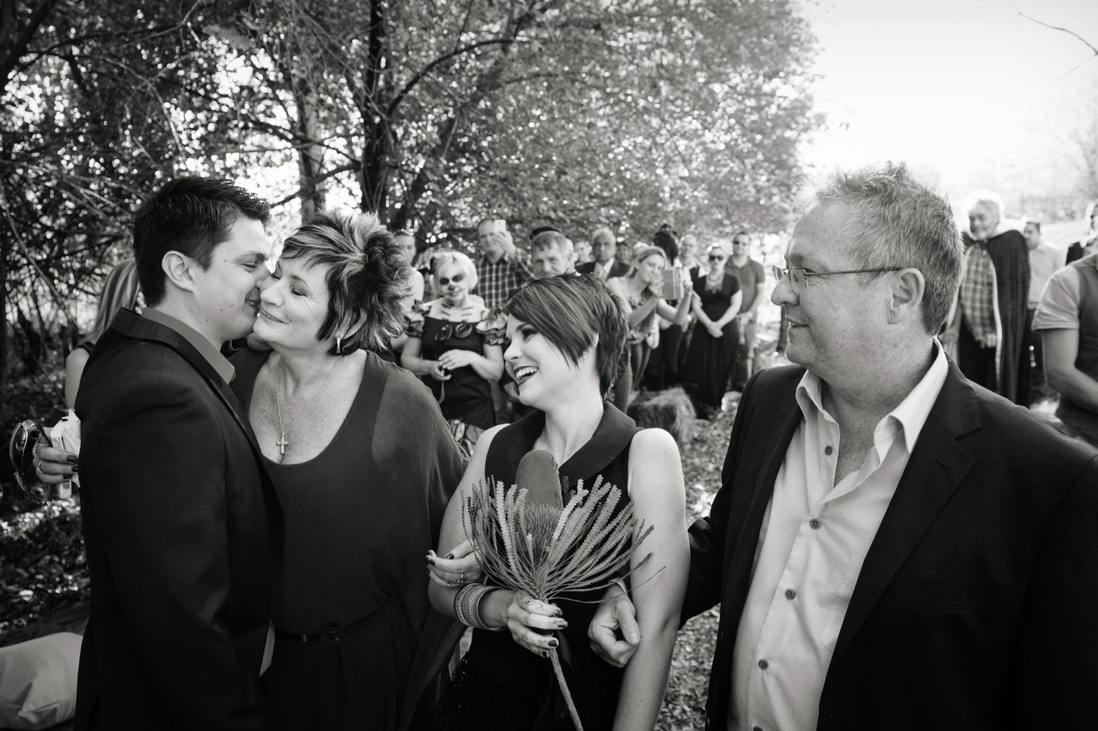bride in black dress with groom