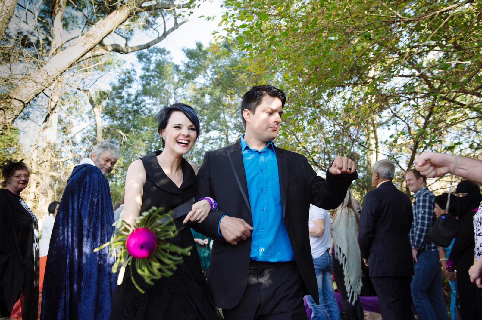 bride in black dress and groom