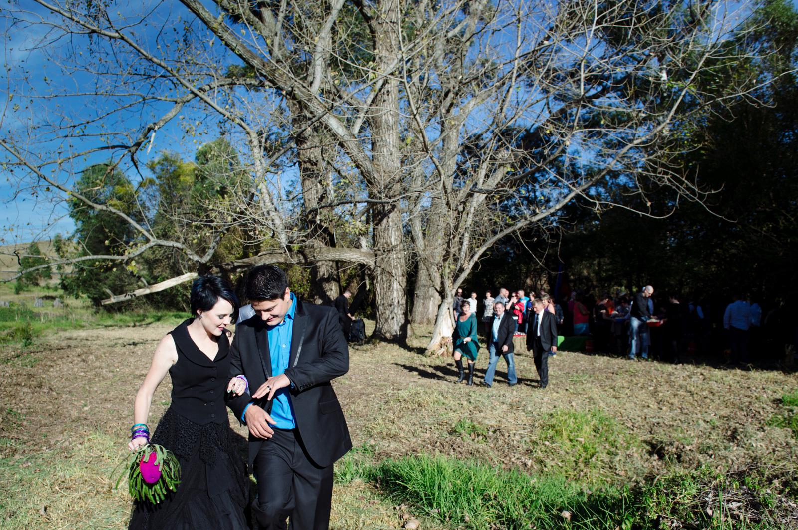 groom and bride in black dress