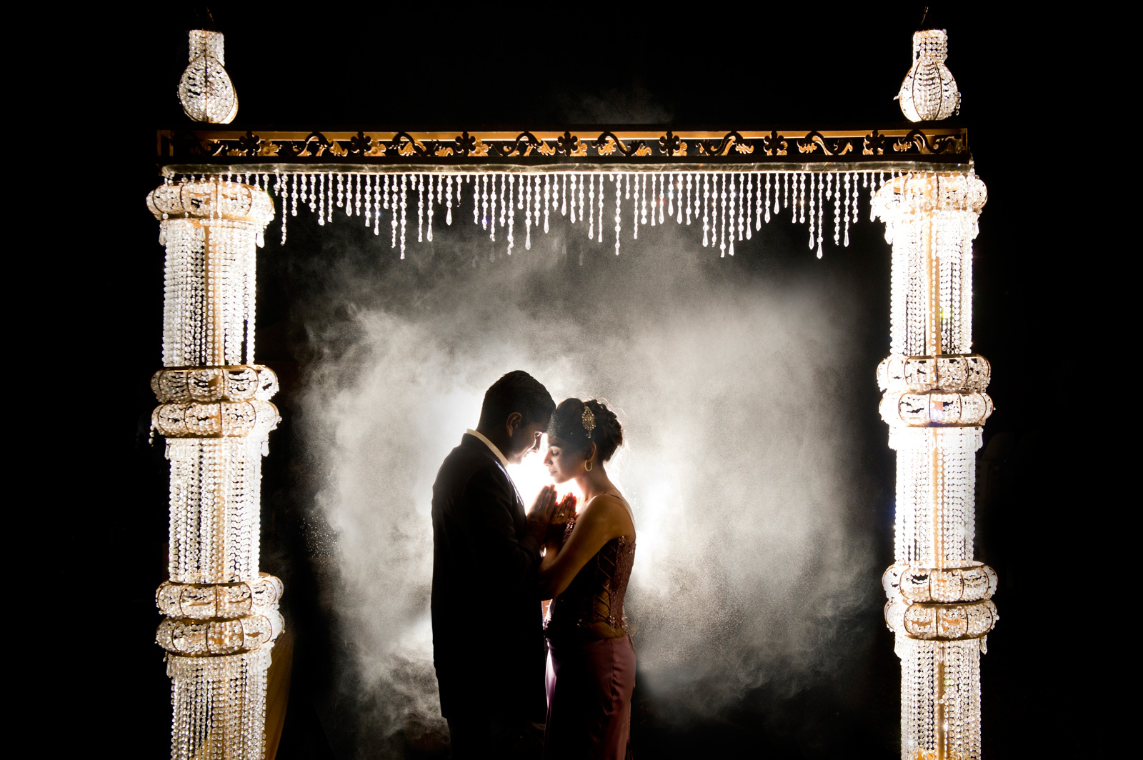 Hindu couple under crystal arch