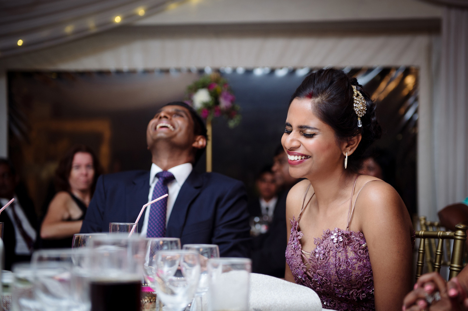 bride and groom laughing at wedding