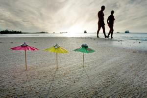 Wedding rings on a beach unbrella