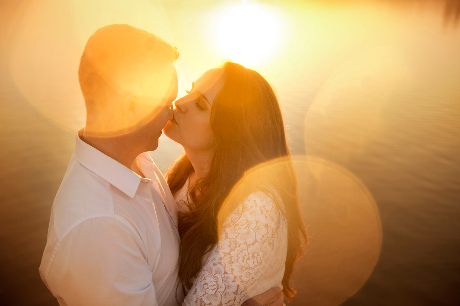 couple kiss with flare