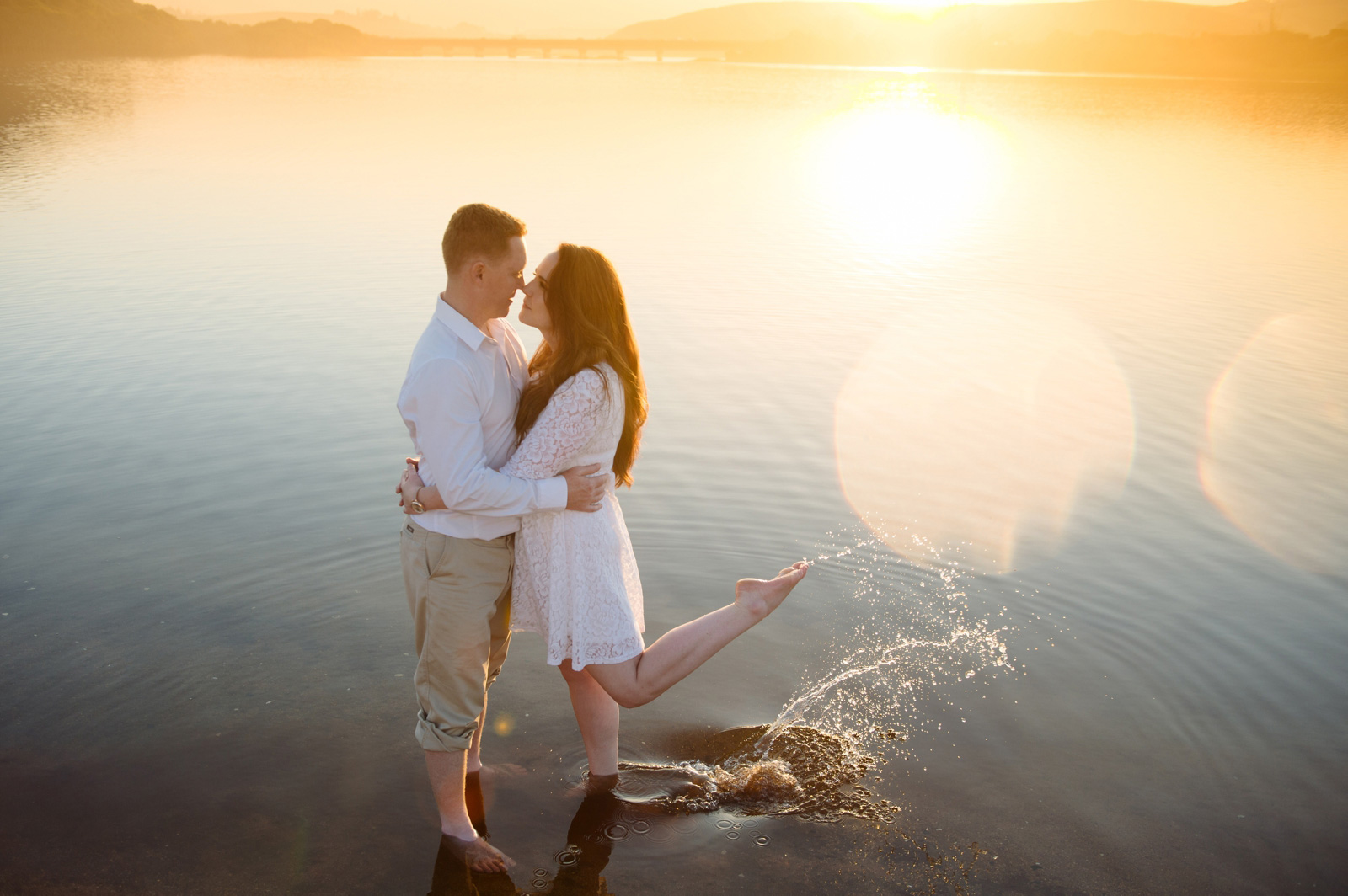 couple in water with amazing light