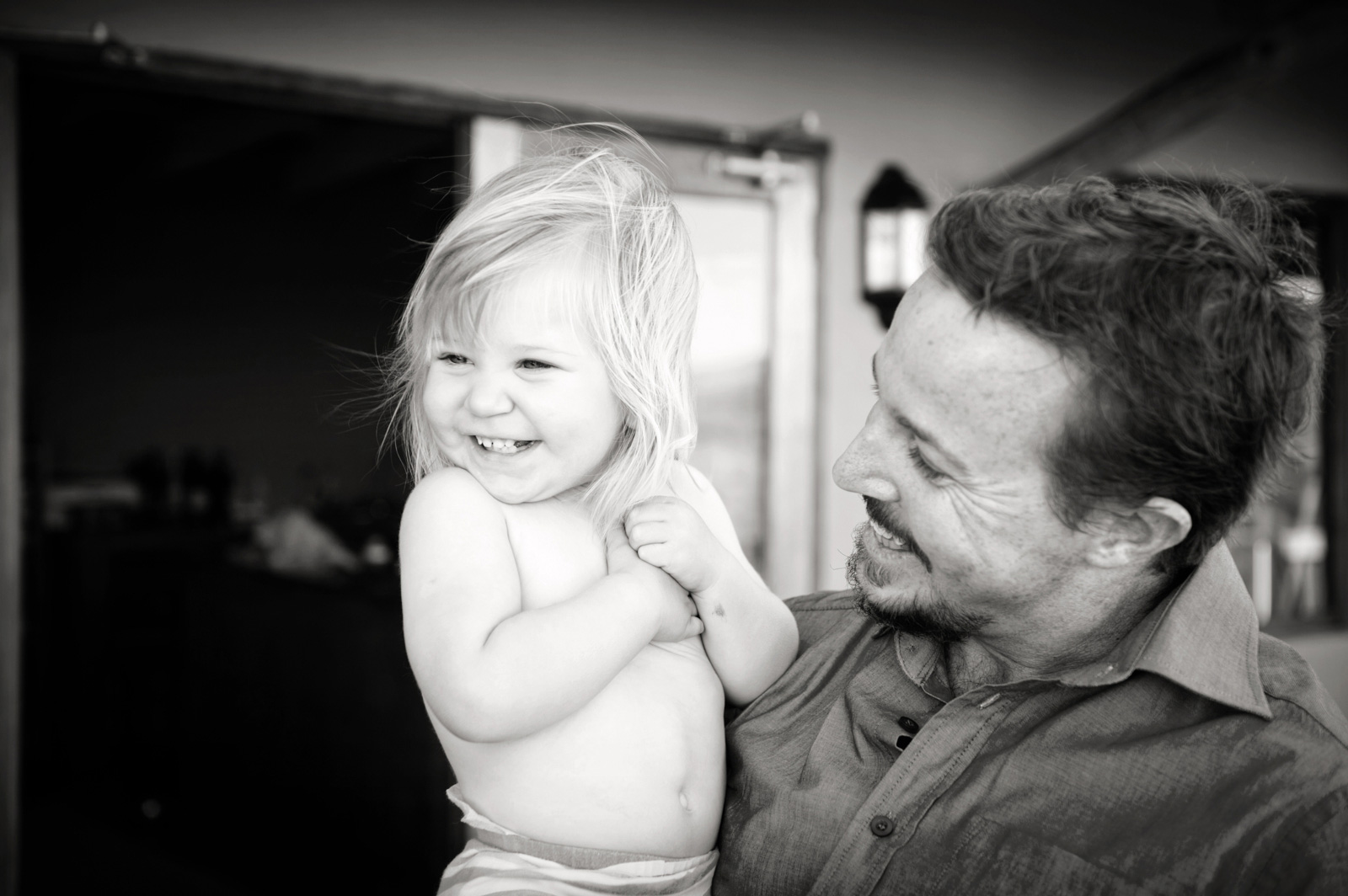 father and laughing daughter