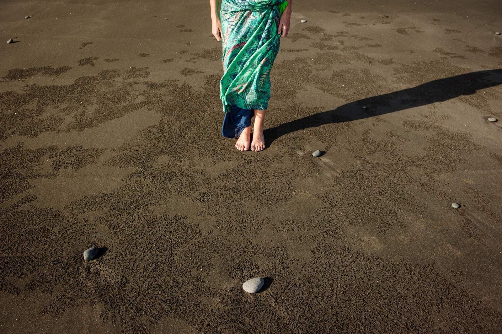 Feet-on-black-beach-sand