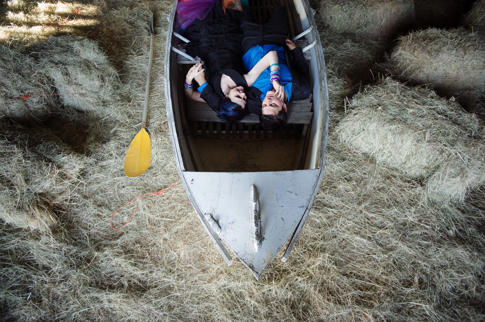 Bride and Groom in a boat with hay