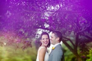 Bride and Groom under Jacaranda Tree