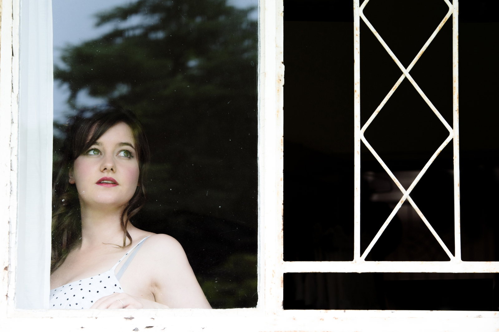 Girl looks out window