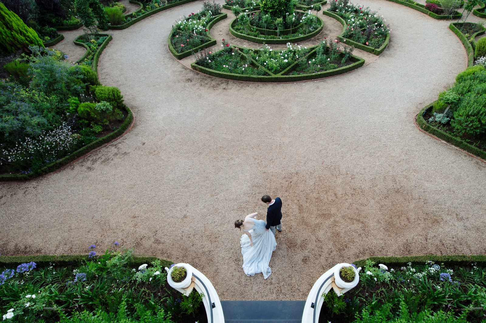 Bride and Groom twirl in gardens