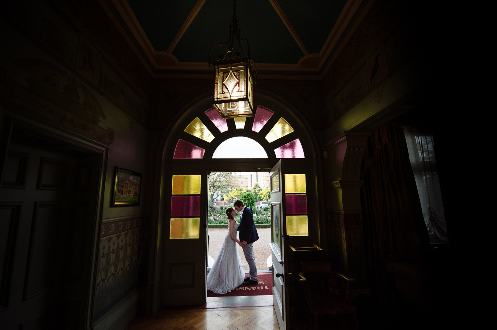 Bride and Groom with stain glass windows