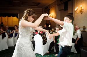 Bride and little brother dance