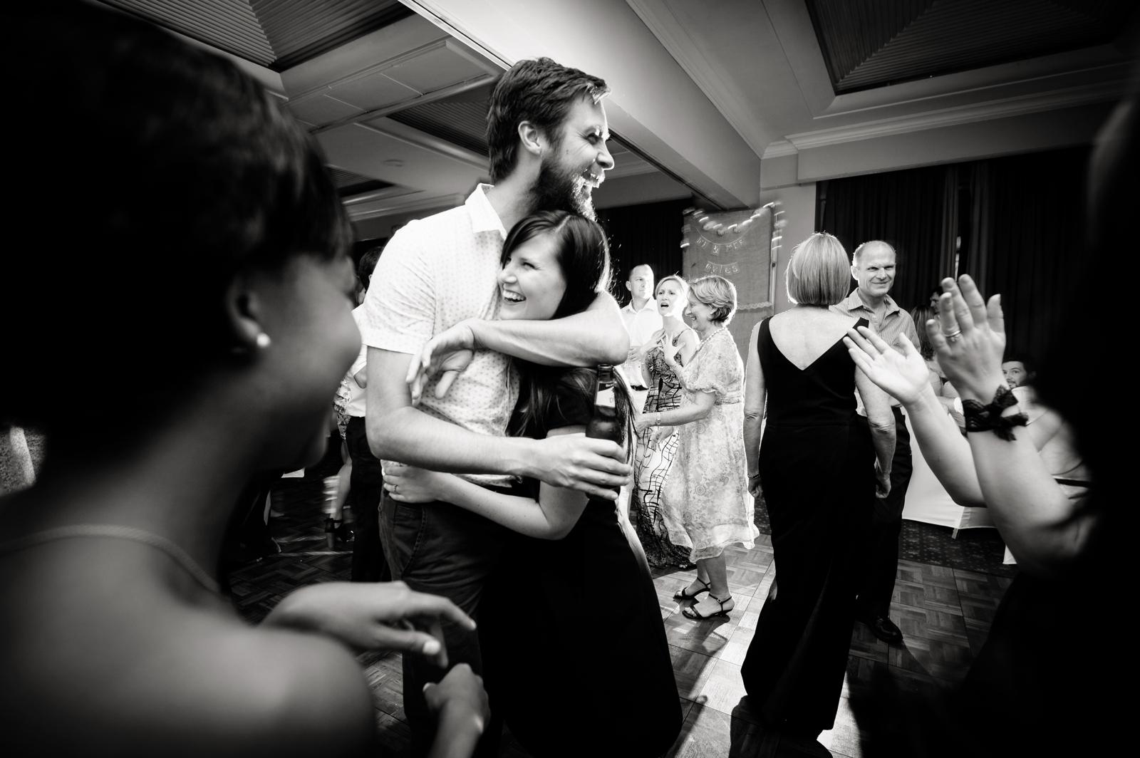 Man and woman hug on dance floor