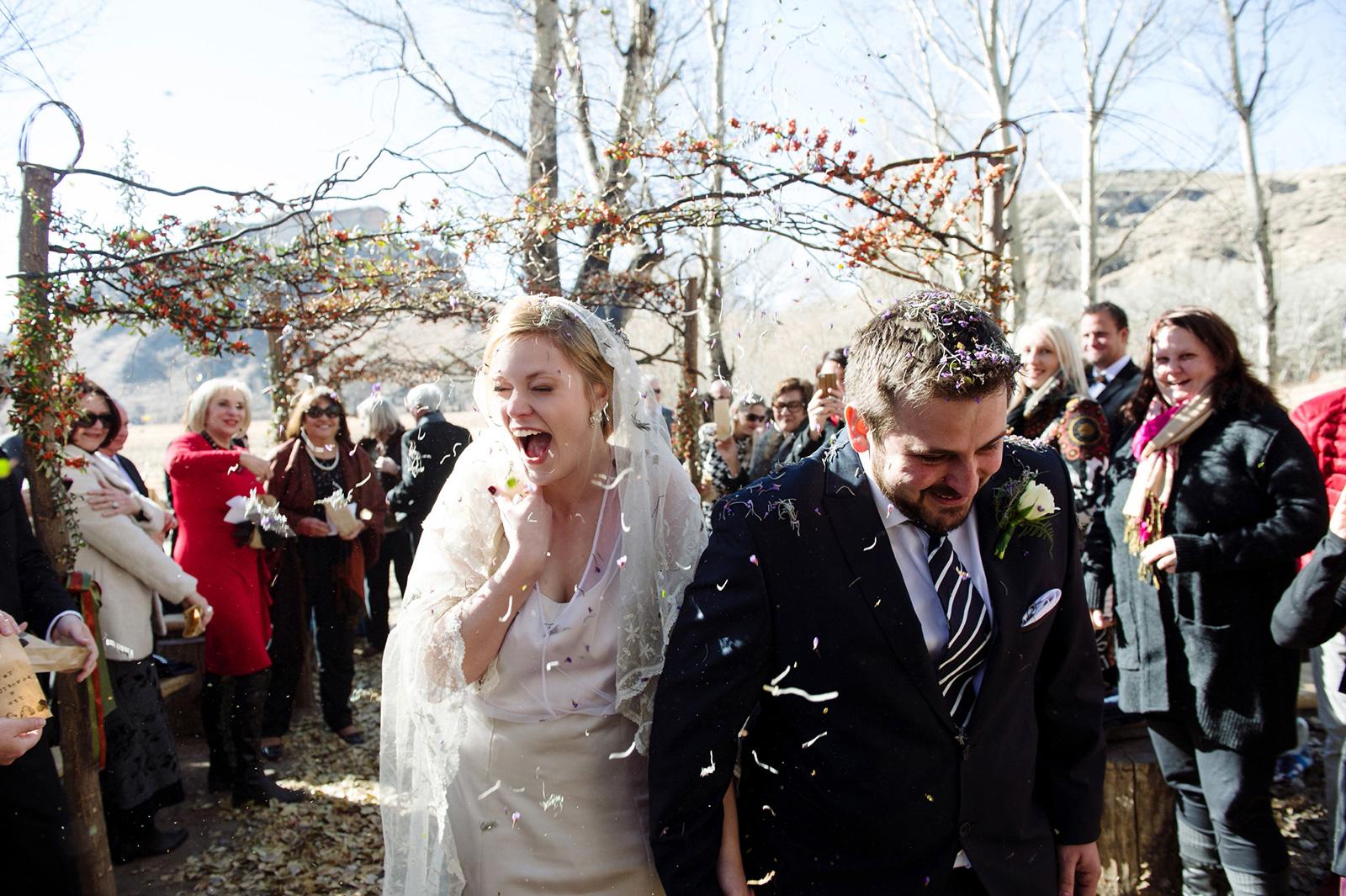 Bride and Groom in lavendar confetti