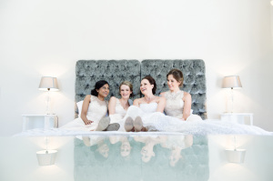 Bride and friends in glass