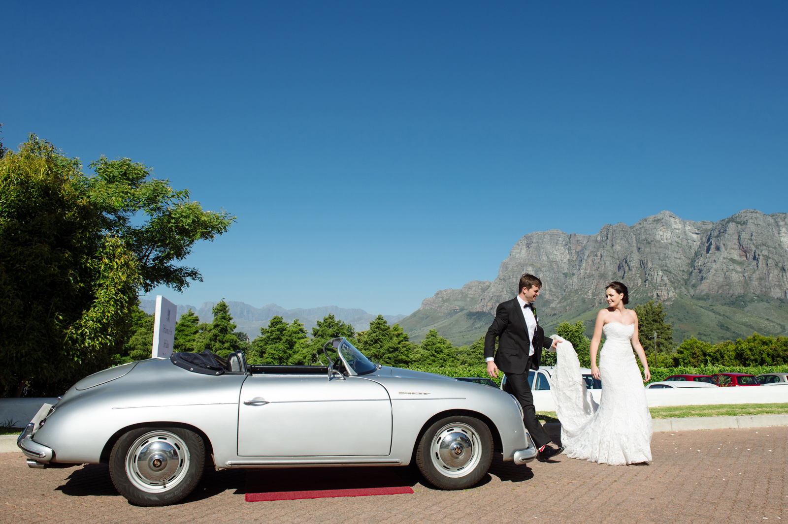 Bride and Groom with Porsche