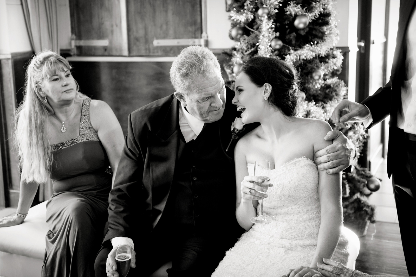 Bride sits on dads lap