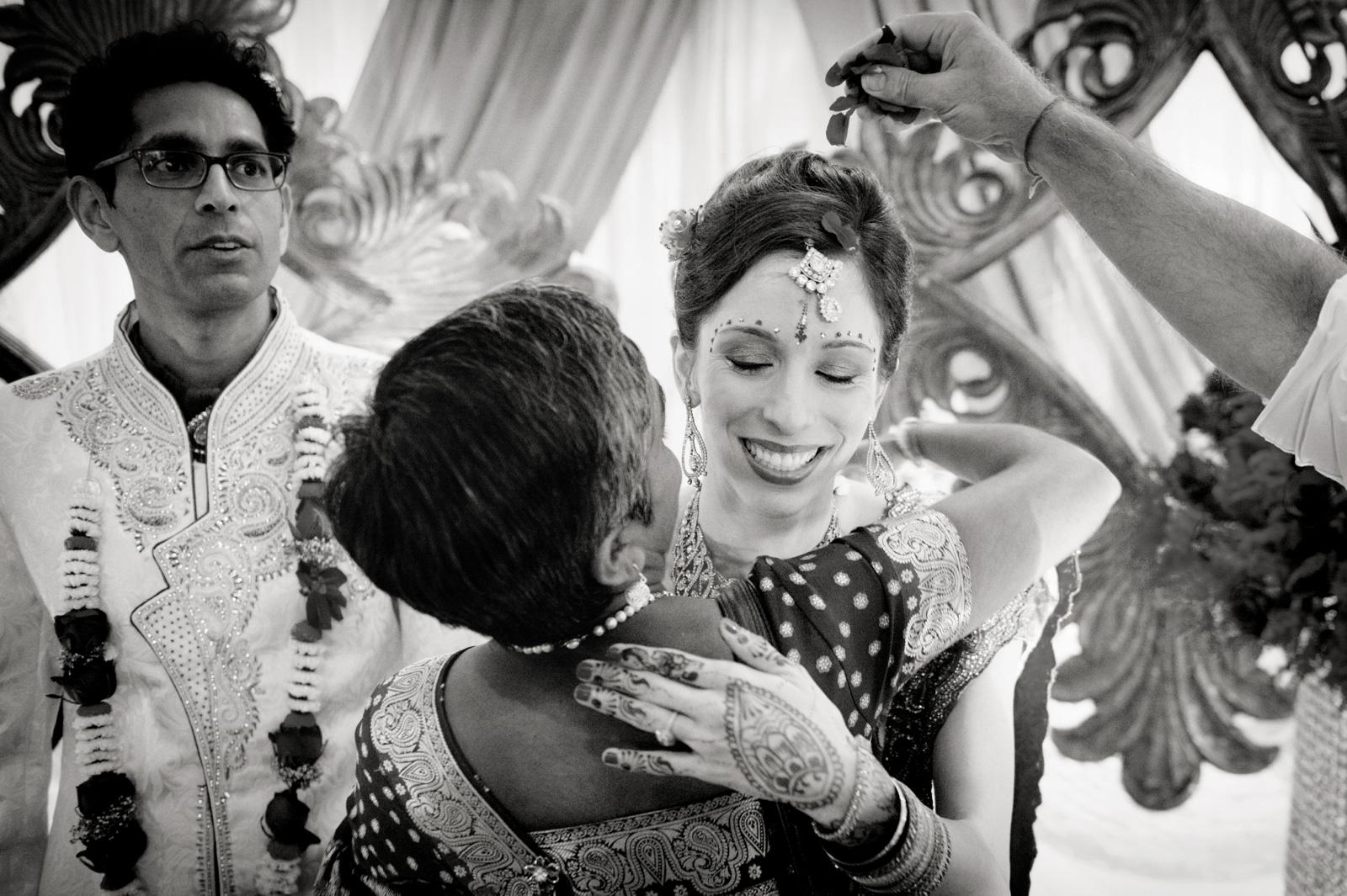 Bride hugs woman