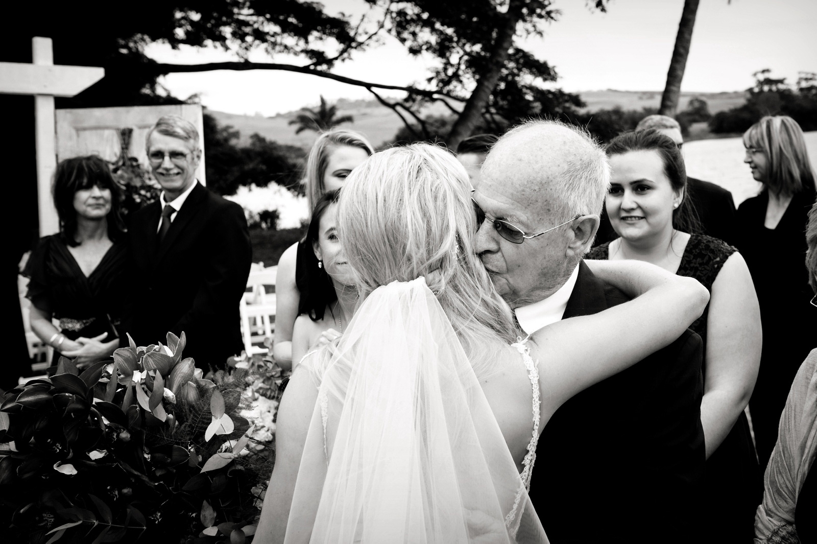 Grandfather kisses bride