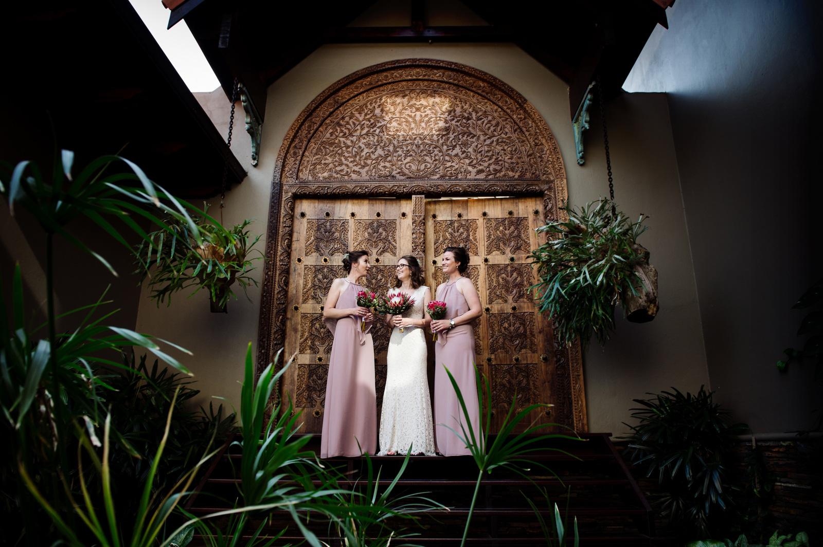 Bride and bridesmaids beautiful door