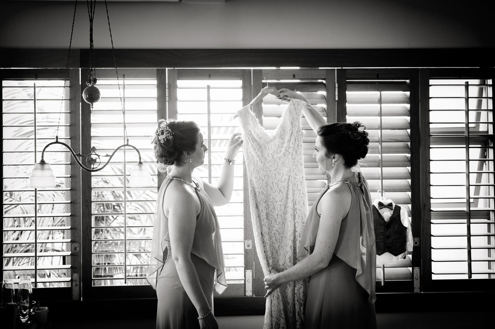 Bridesmaid with wedding dress