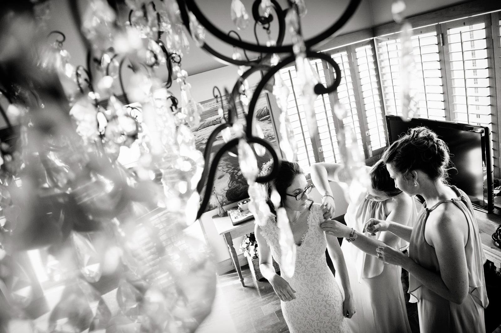 Bride through chandelier