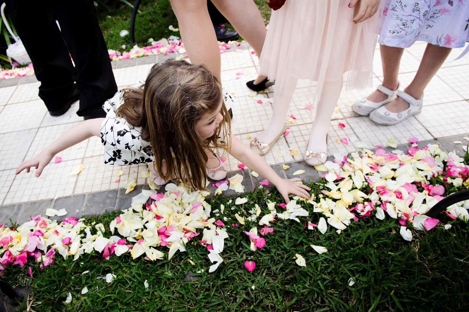 Child picking up petals