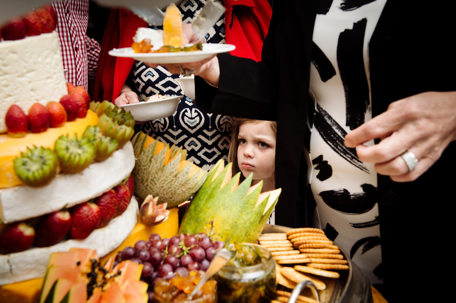 Unhappy child with healthy food