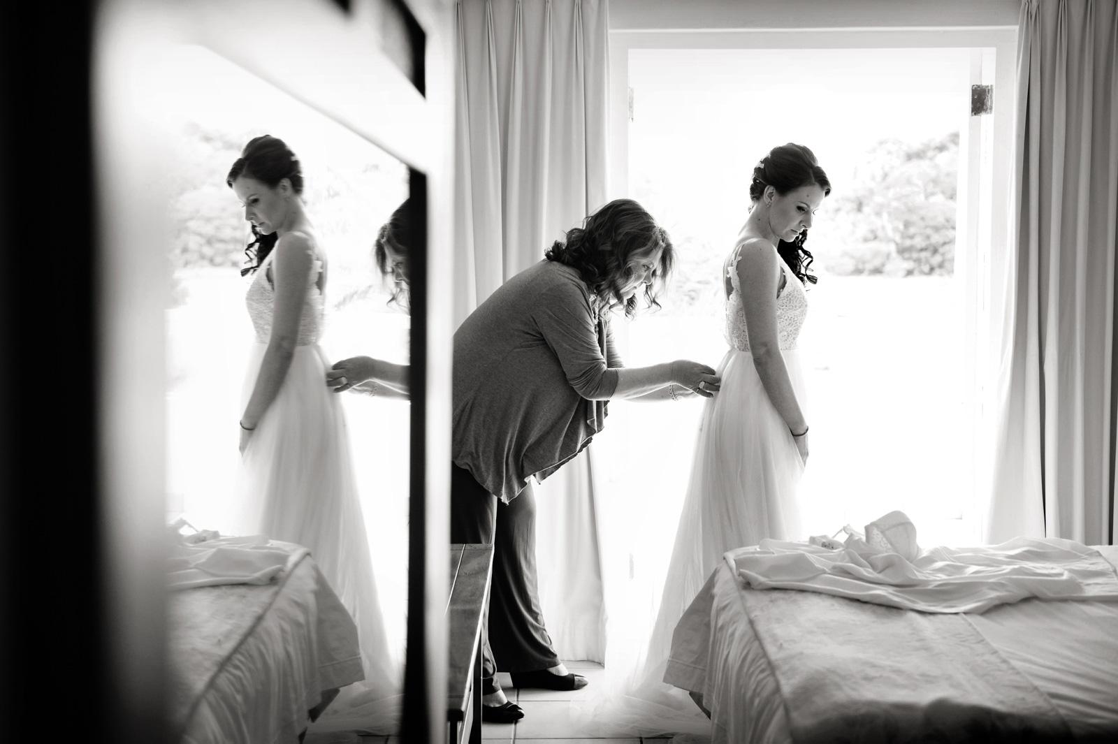 Mom dressing bride