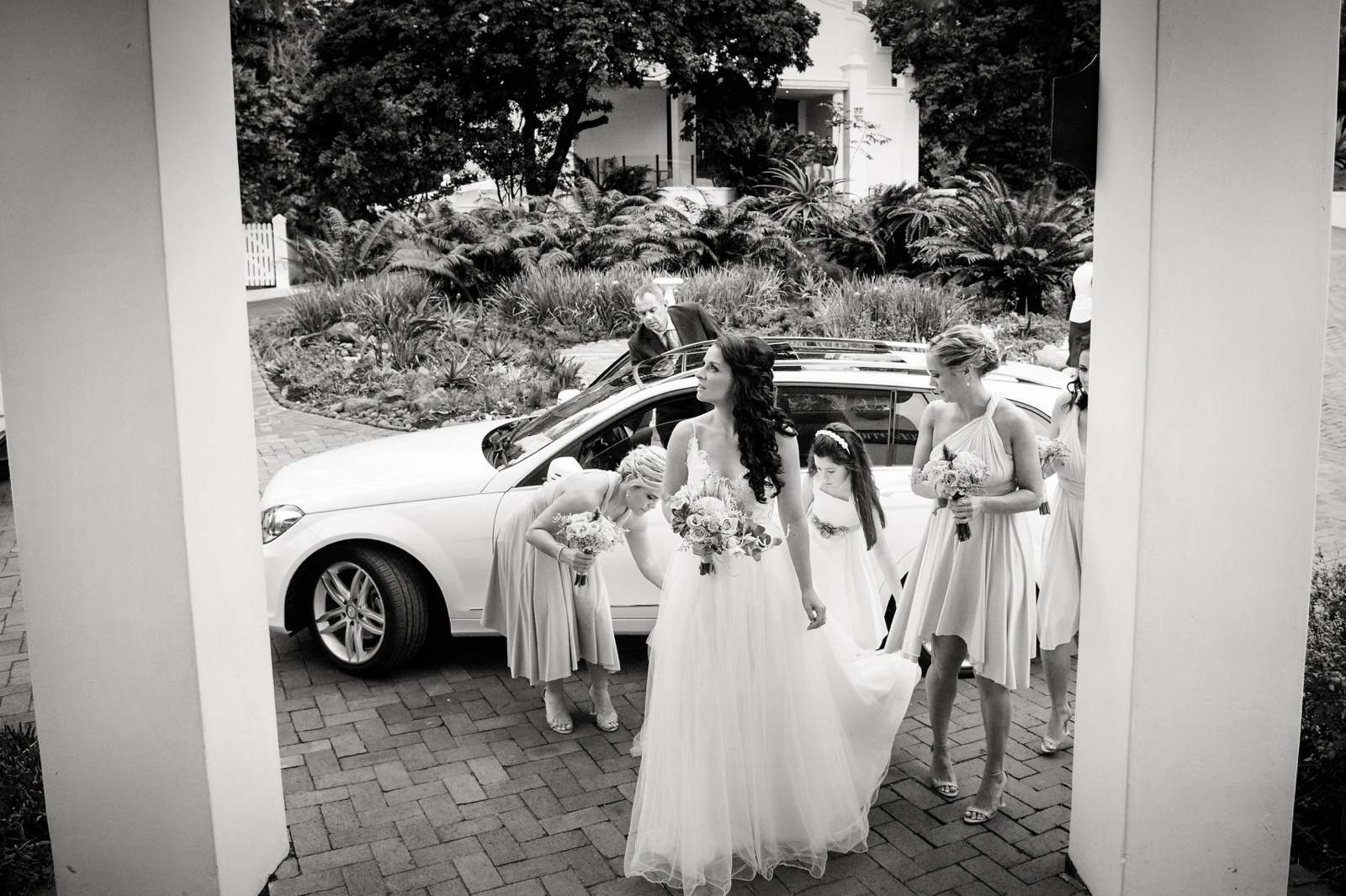 Bride arriving in rain