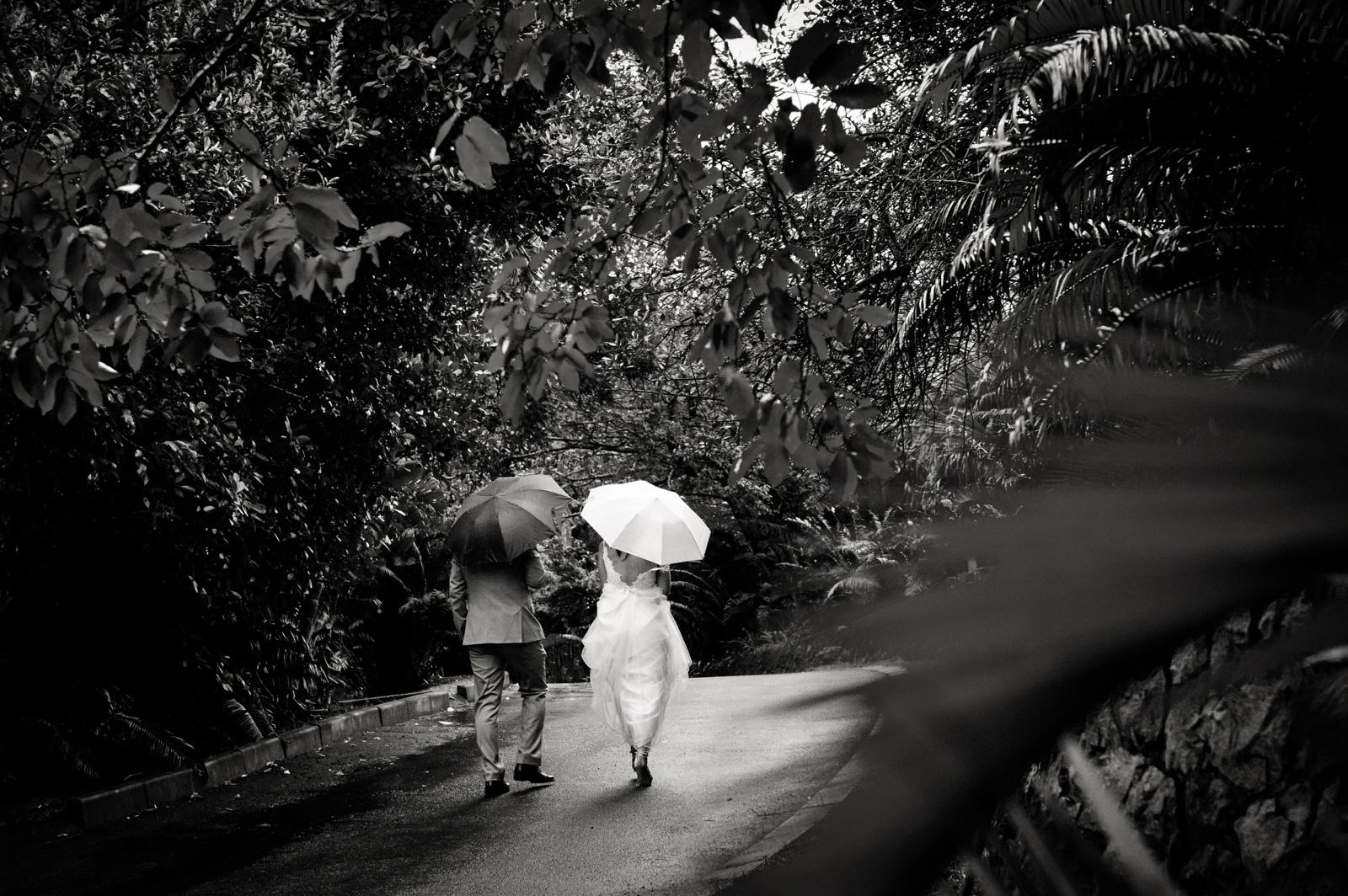 rainy wedding bride and groom walking